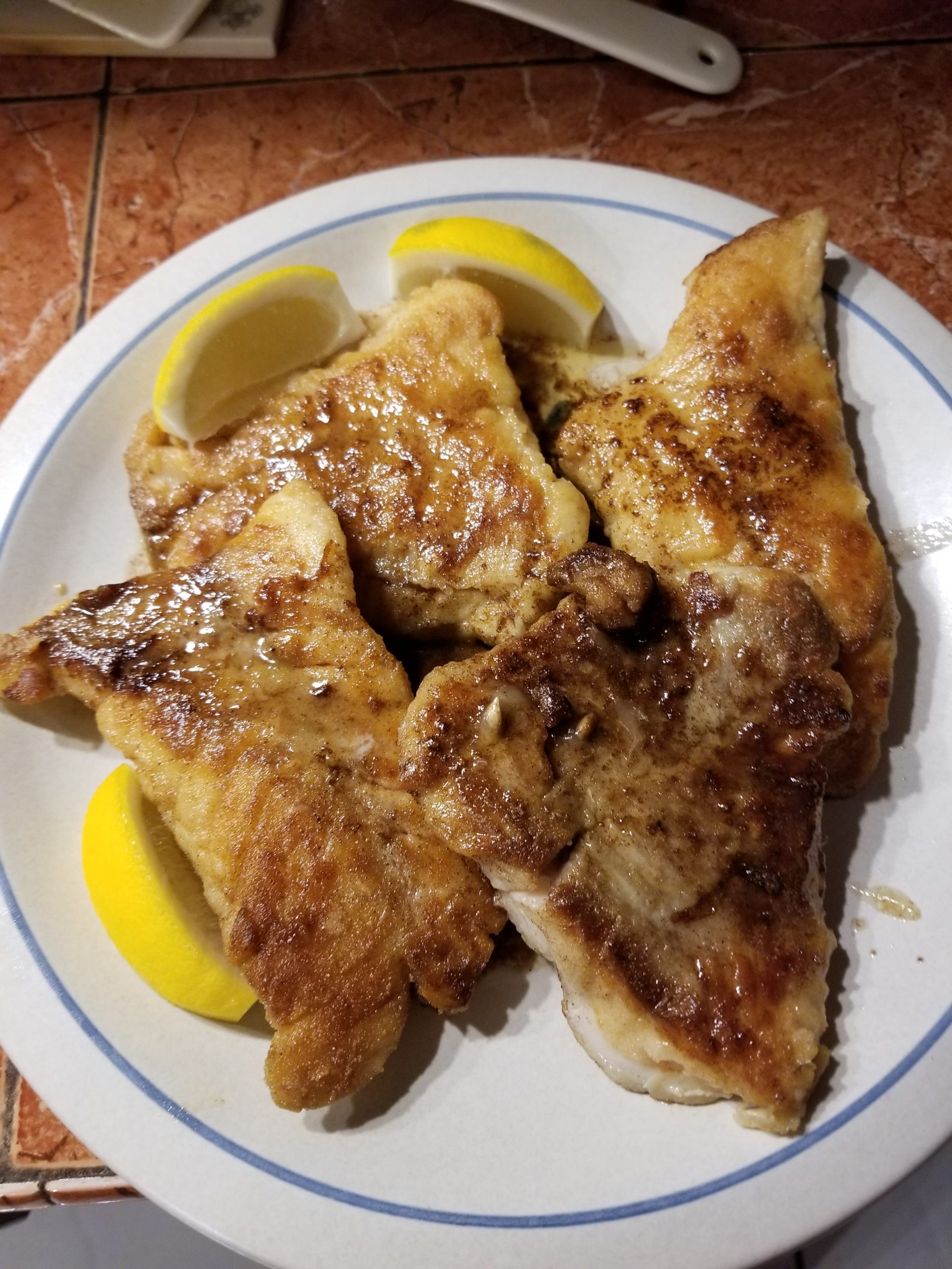 shows some lightly breaded pan fried fish